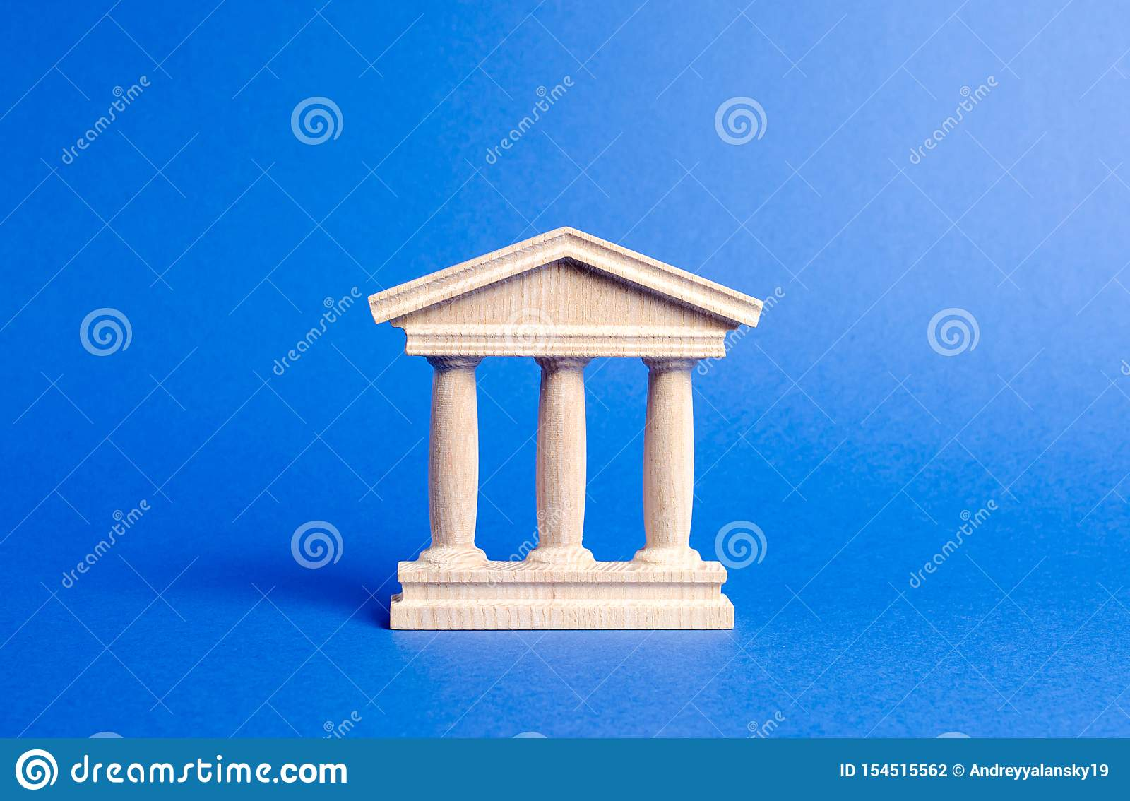 Building figurine with pillars in antique style. Concept of city administration, bank, university, court or library. Architectura