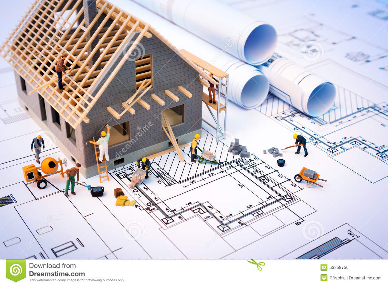 Building house on blueprints with worker stock photo for Home construction project plan