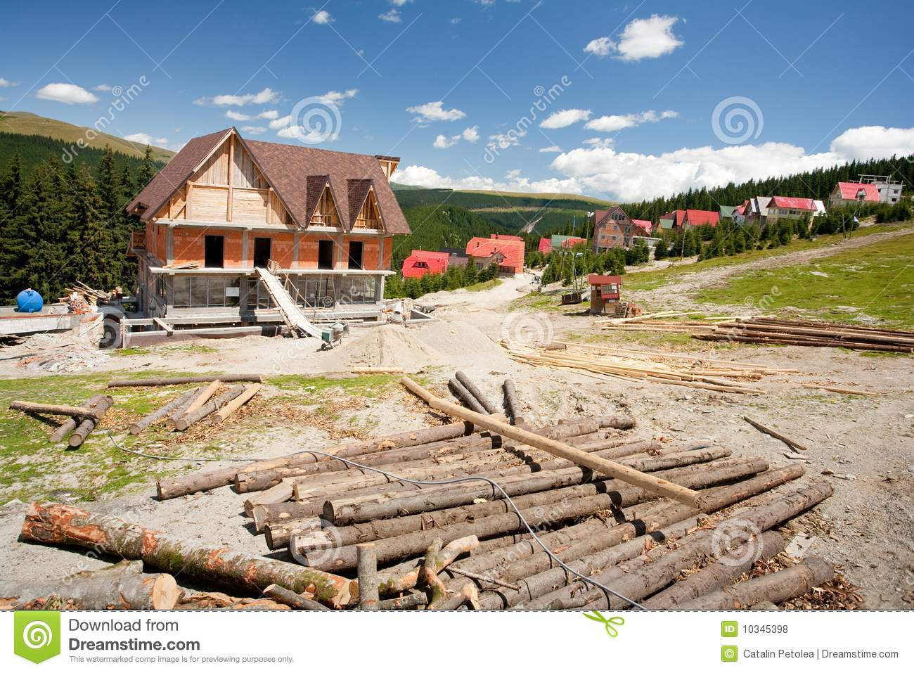 Building A House In Mountains Royalty Free Stock Photos