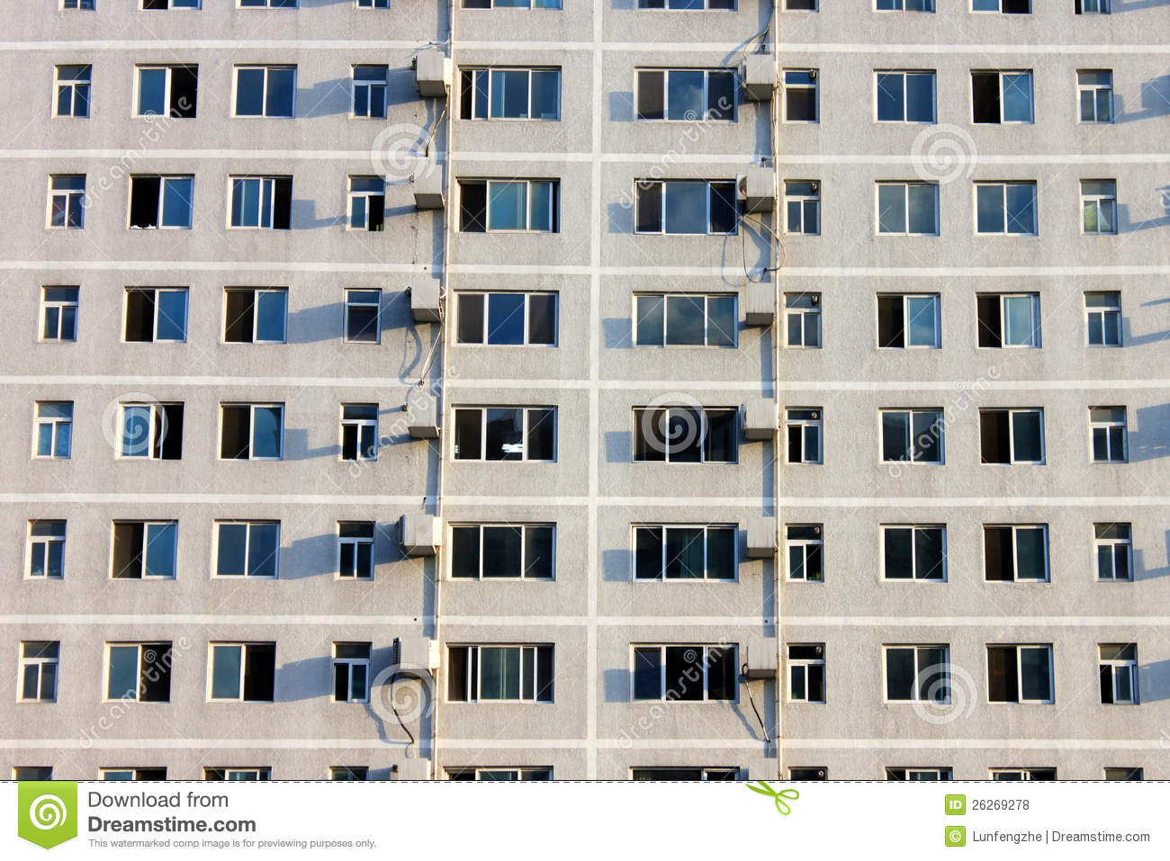 Building with a lot of crowded window stock photo image Building on a lot