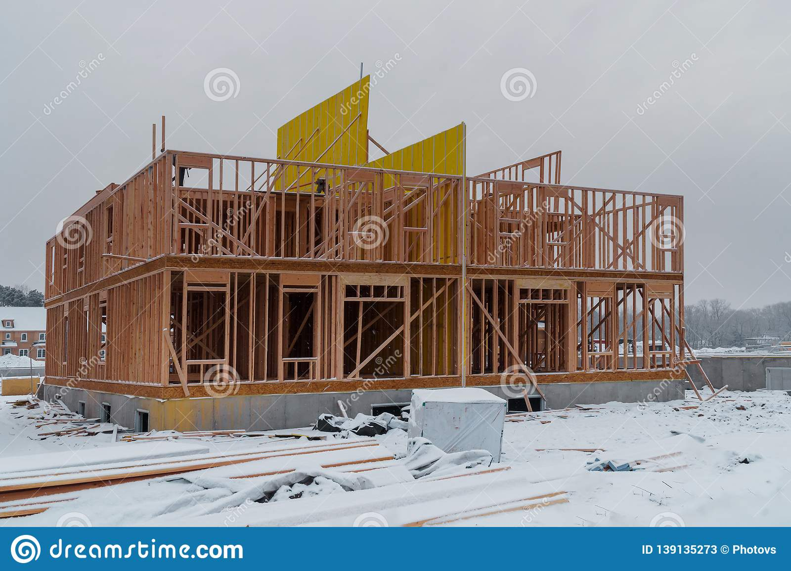 Building of New Home Construction exterior wood beam construction