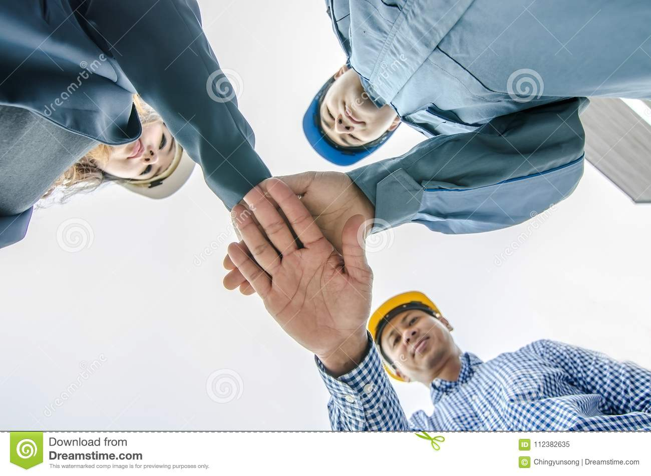 building, partnership, gesture and people concept , stacking hands express their teamwork and cooperation