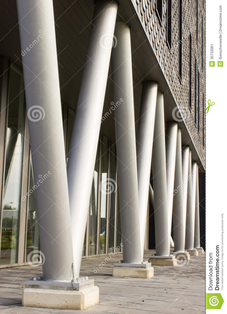 Black Metal Pillar Building : Building on pillars stock image of column