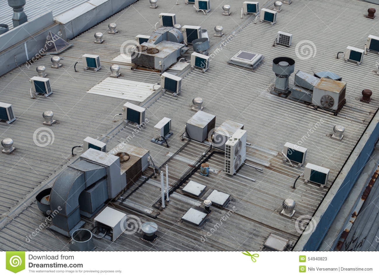 A Building Roof With Multiple Air Conditioning Units Stock