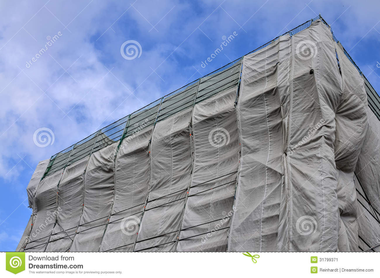 Building Construction Site Covered In Gray Tarpaul Stock