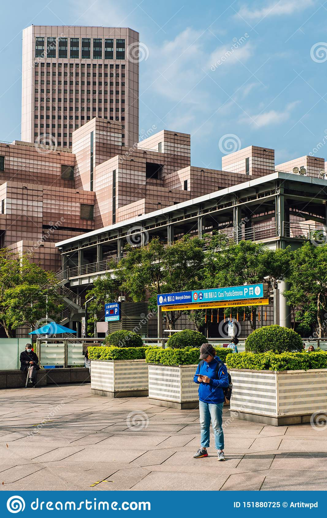 Building of Taipei World Trade Center Post Office. Decorated with white and light red color tiles with tourist standing.