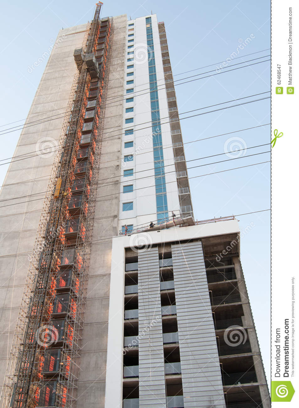 Building Under Construction With Exposed Elevator Stock Image