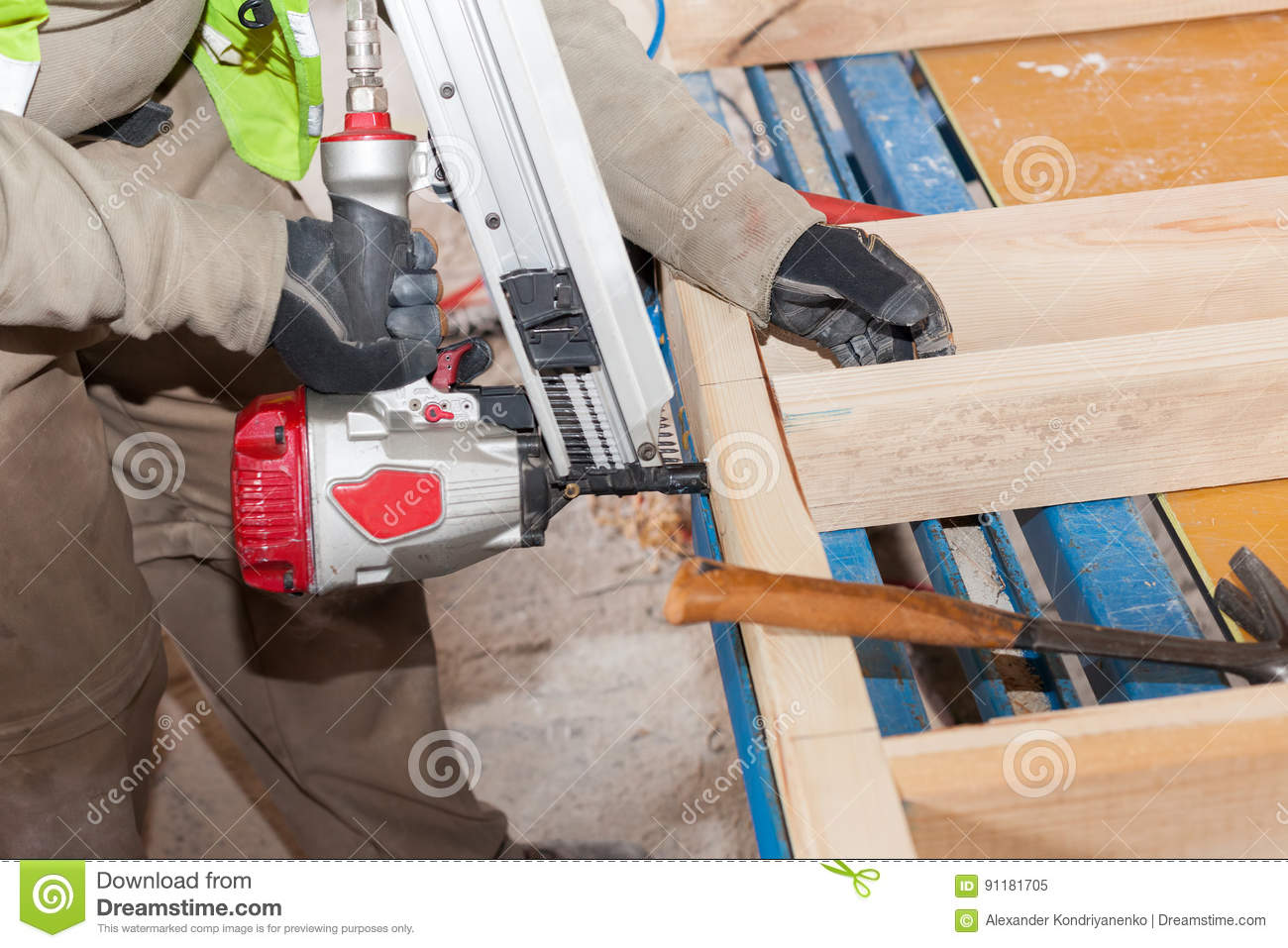 Building A Wall For Frame House.Worker Use Framing Nailer To Attach ...