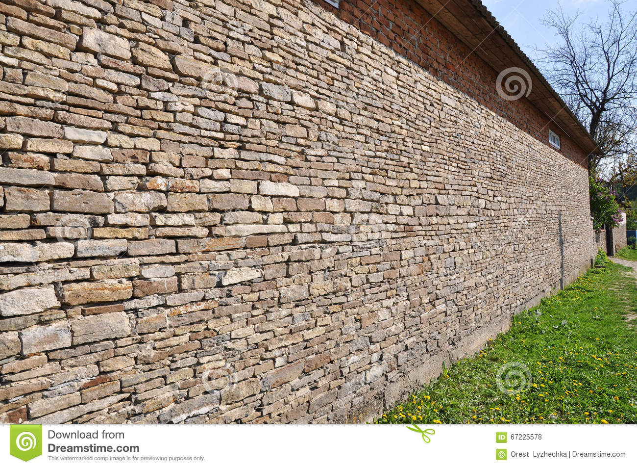 Residential Natural Stone : Building walls with slabs of natural stone stock photo