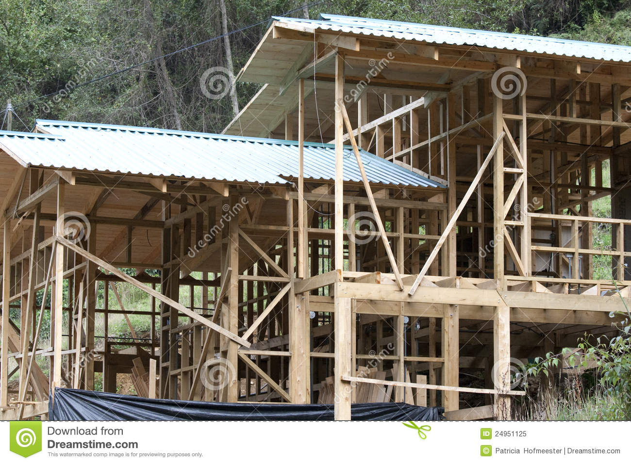 Building of a wooden house on a slope royalty free stock for Building a house on a slope
