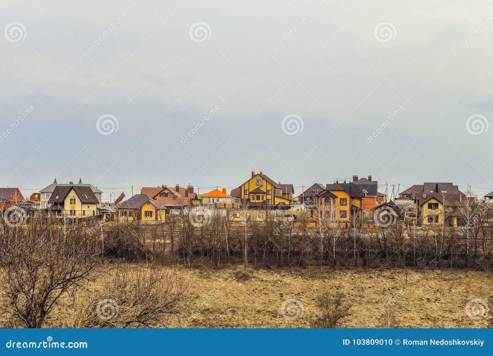 Buildings individual suburban housing in early spring. Belgorod Region, Russia.