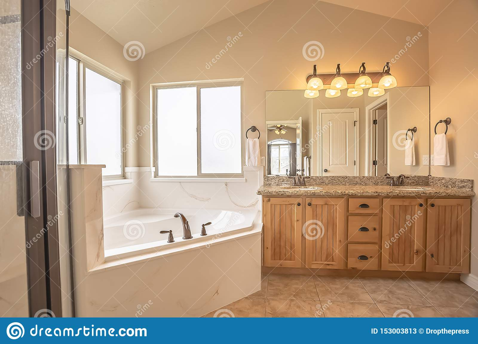 Built In Bathtub At The Corner Of A Home Bathroom With Tile Floor And Beige Wall Stock Image Image Of Interior Room 153003813