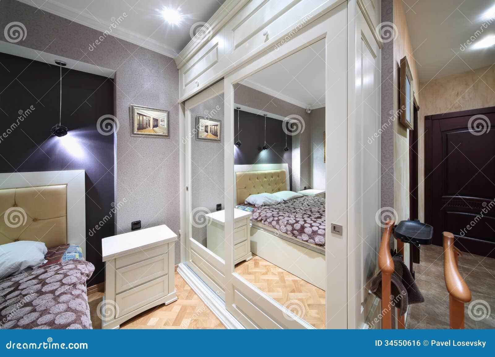 Built in White Wardrobe With Mirrored Doors In Bedroom