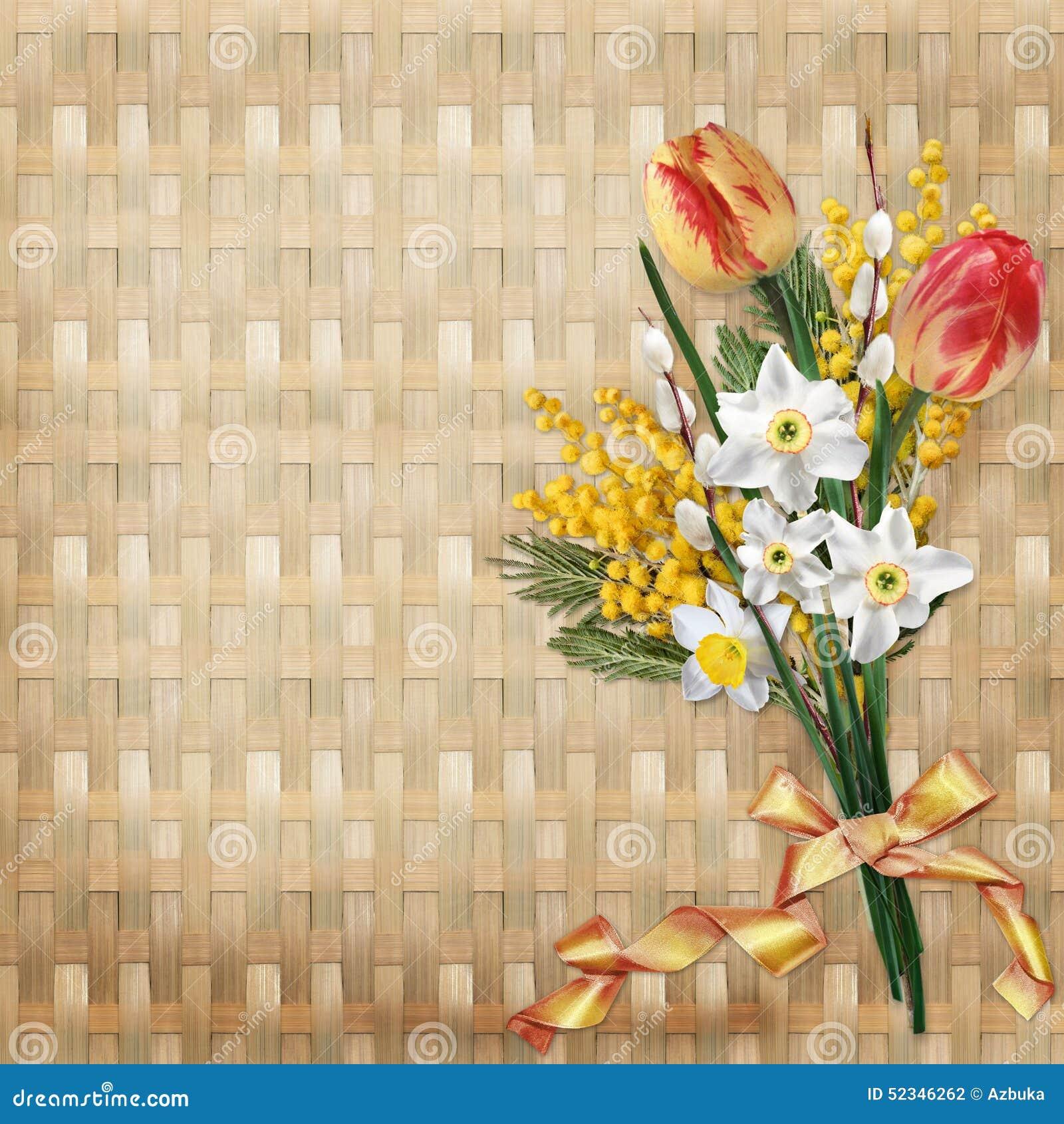 Buketten av våren blommar i en vide- bakgrund