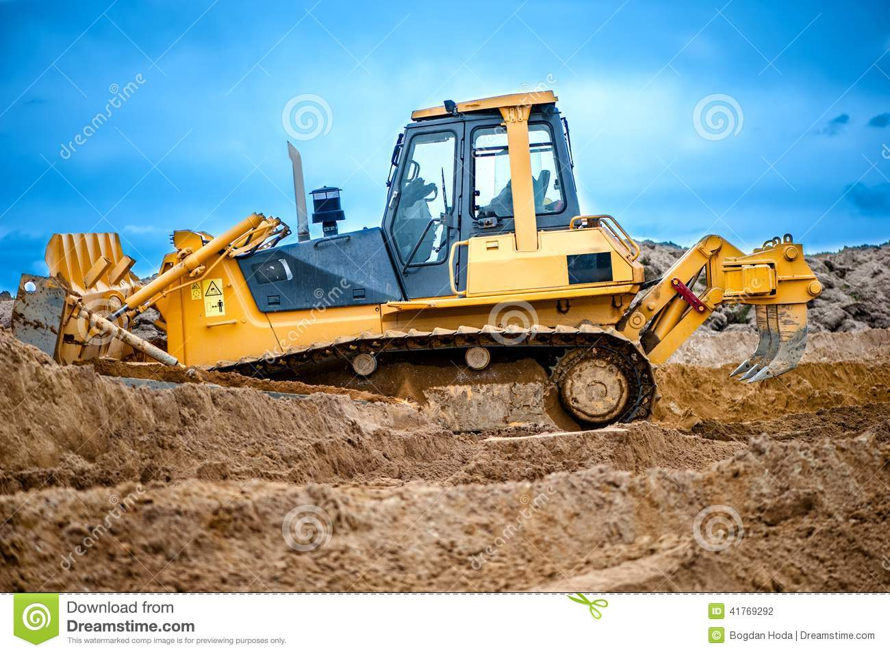 Construction Site Soil : Bulldozer or excavator working with soil on construction