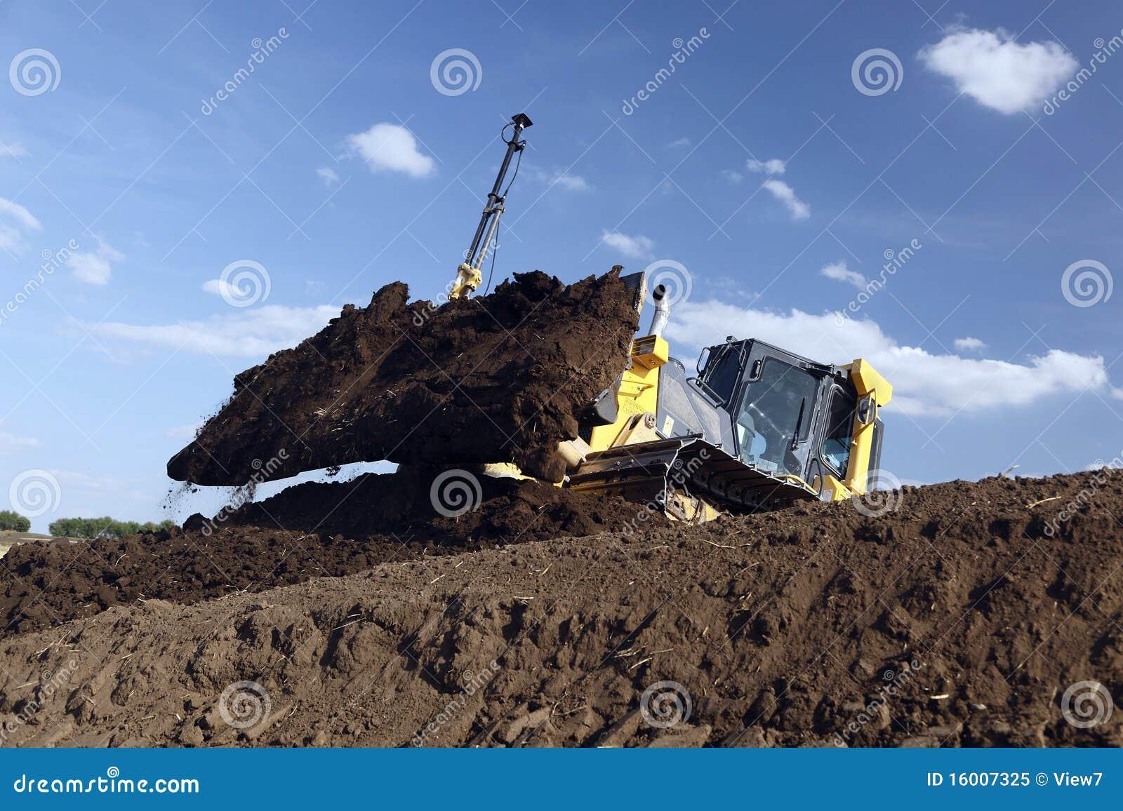 Bulldozer moving dirt
