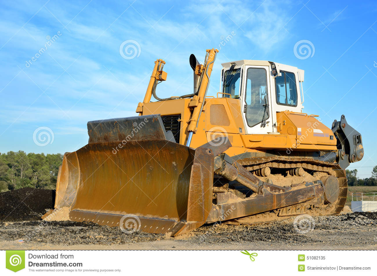 Man On Bulldozer : Bulldozer stock photo image