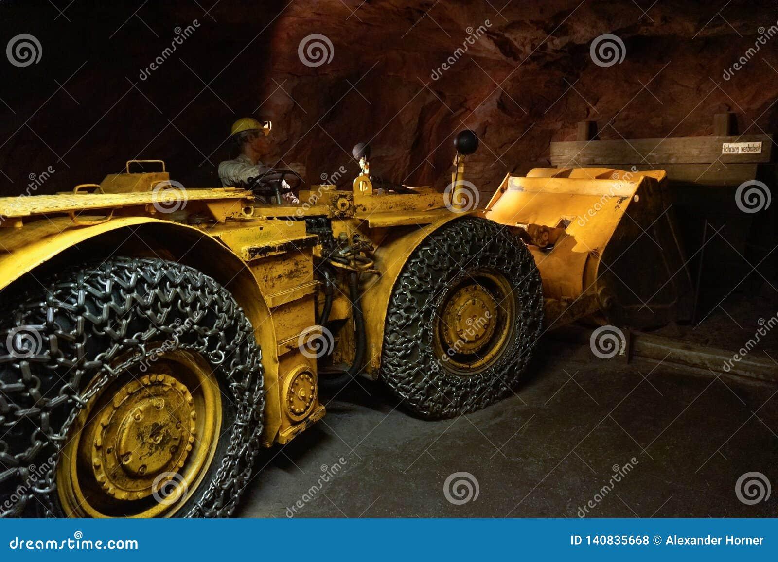 Bulldozer working in tunnel pushing gravel outside