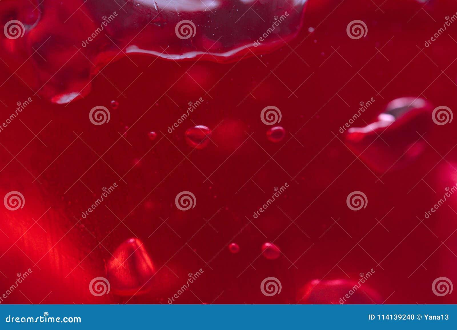 Bulles d air dans une gelée rouge le fond de la gelée