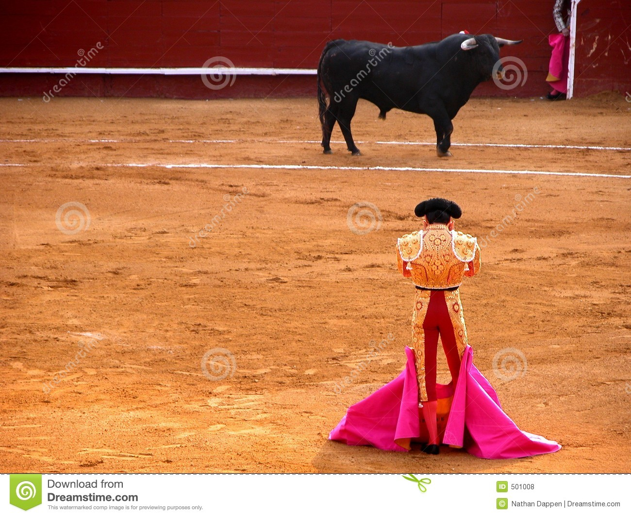 Bullfighter and bull in a standoff