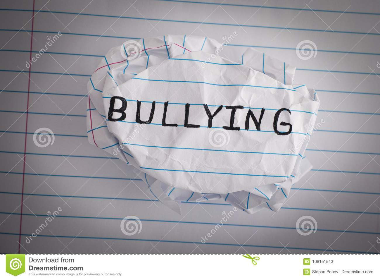 Bullying. Crumpled paper ball with word Bullying