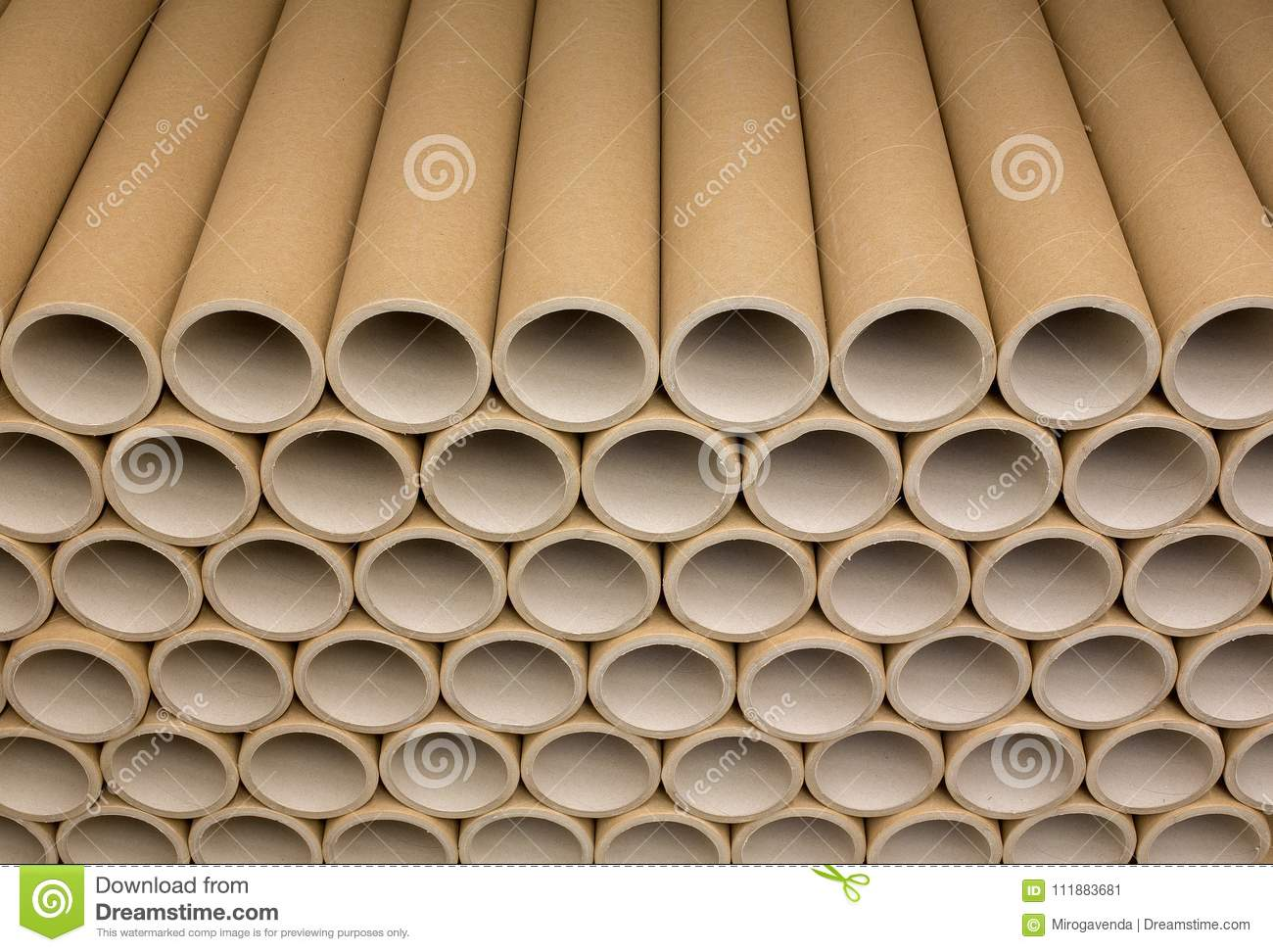 A bunch of brown industrial paper core. A lot of paper cores or paper tubes.