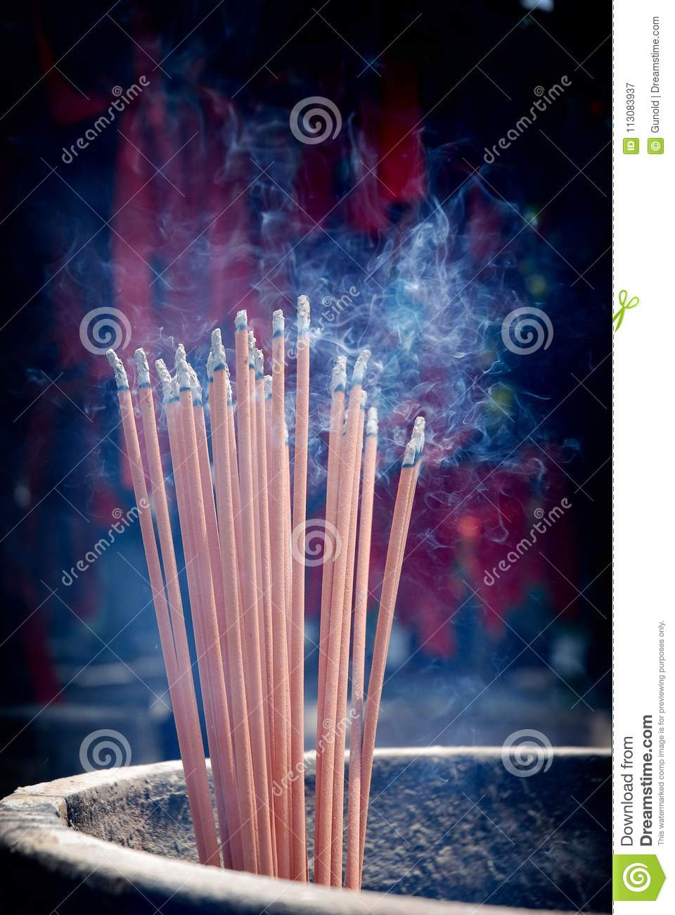 A bunch of glowing incense sticks