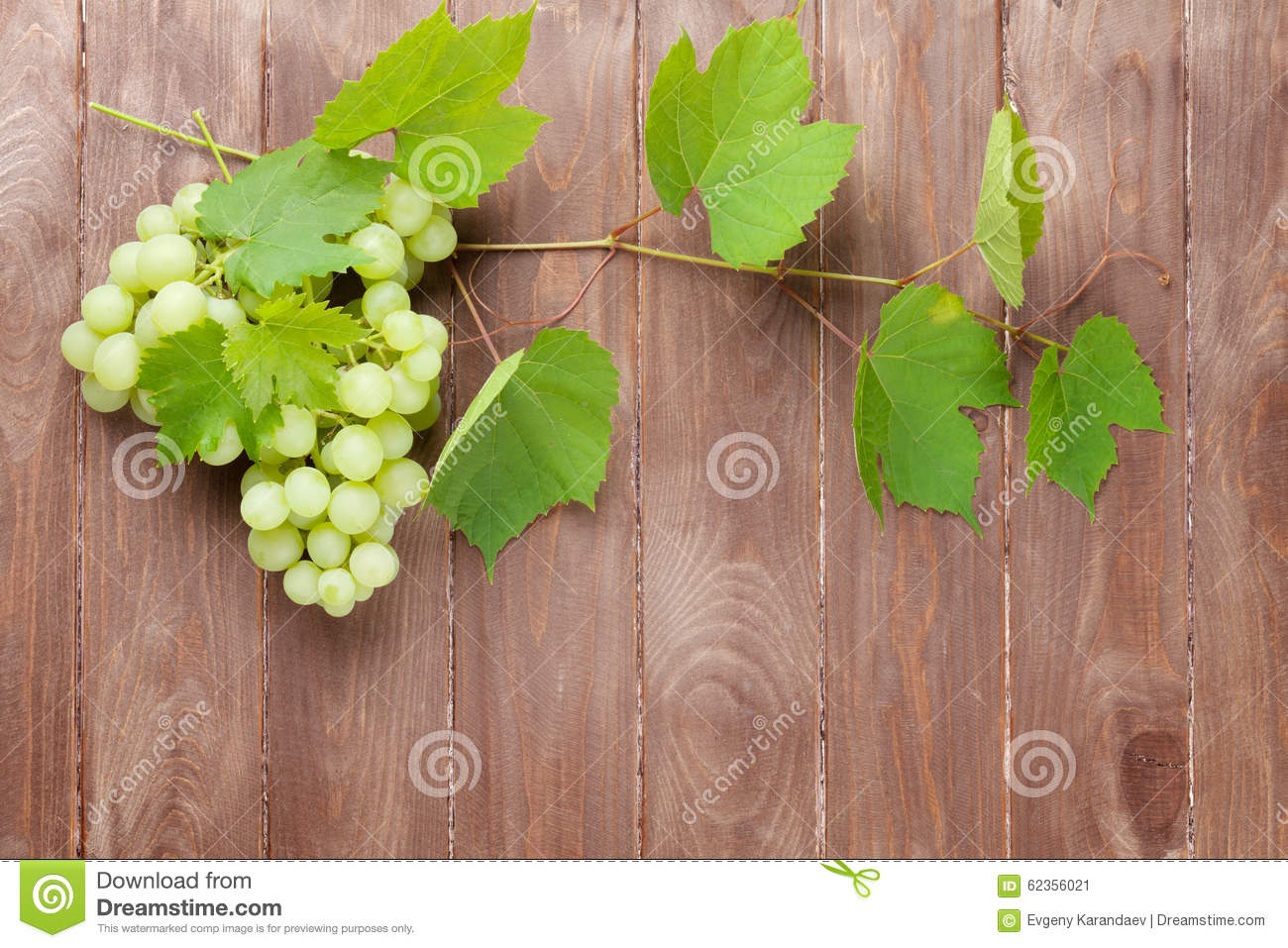 Bunch of grapes and vine on wooden table stock image for Table and vine