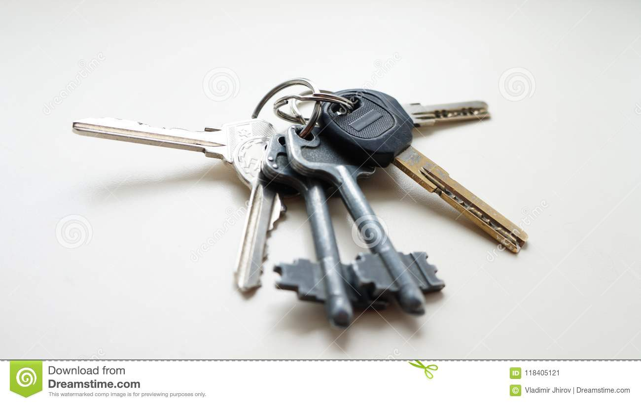 A bunch of keys on a white background