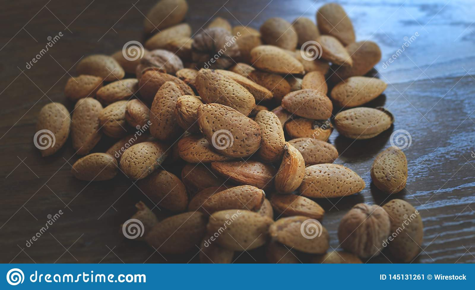 Bunch of pine nuts on a wooden table