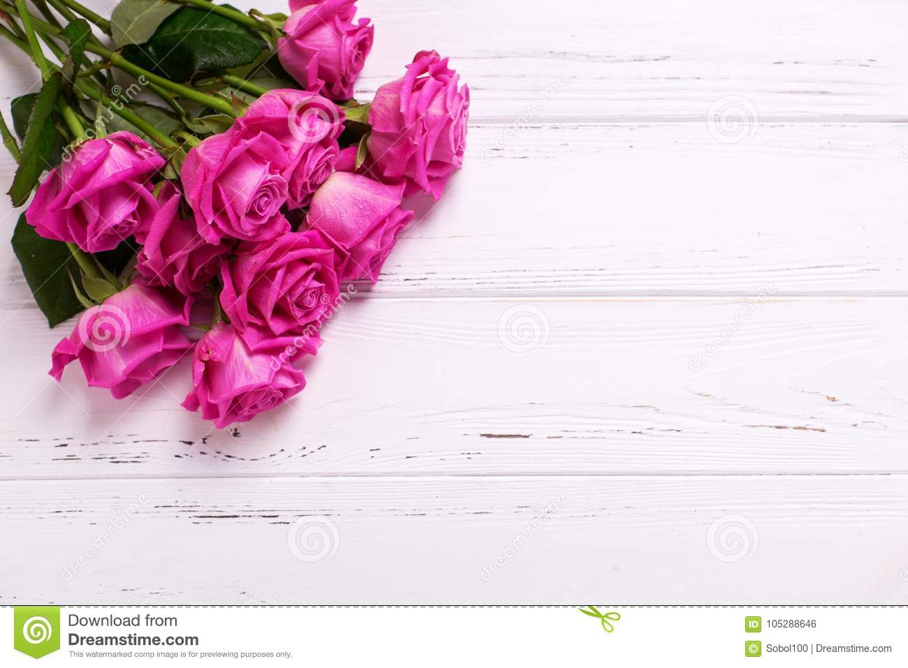 Bunch Of Pink Roses Flowers On White Wooden Background Stock Photo