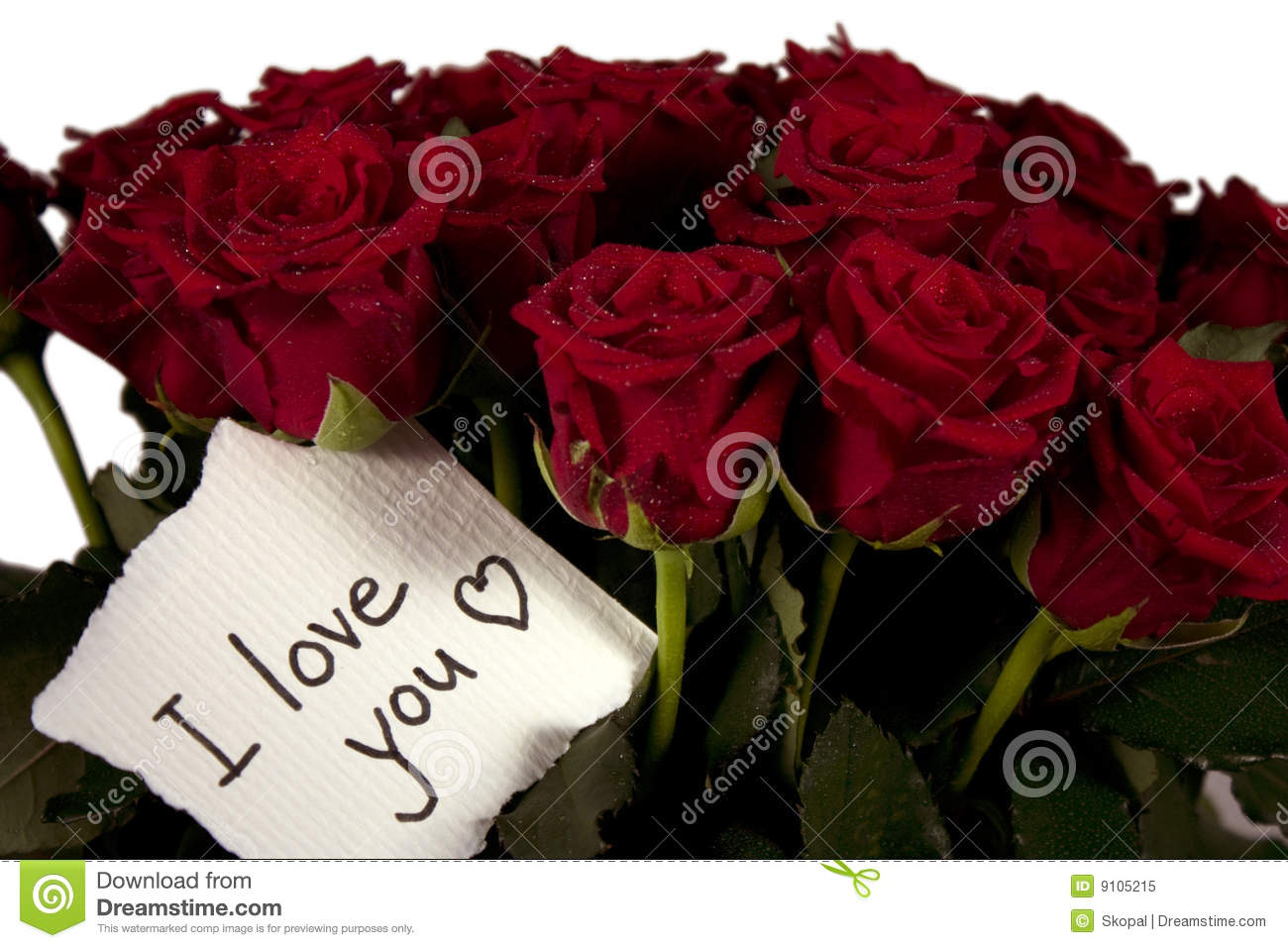bunch of roses in glass vase with note - I love you.