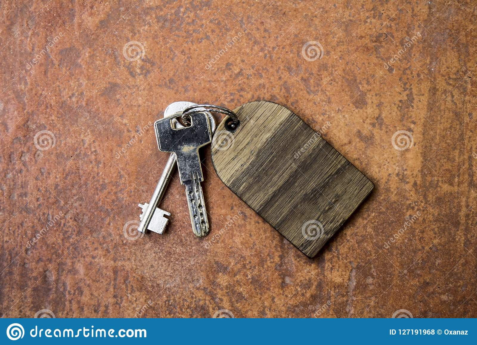 Bunch of scrached keys with empty wooden label