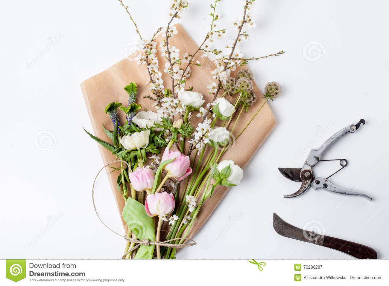 Bunch Of Spring Flowers On Wrapping Paper With Implements Stock