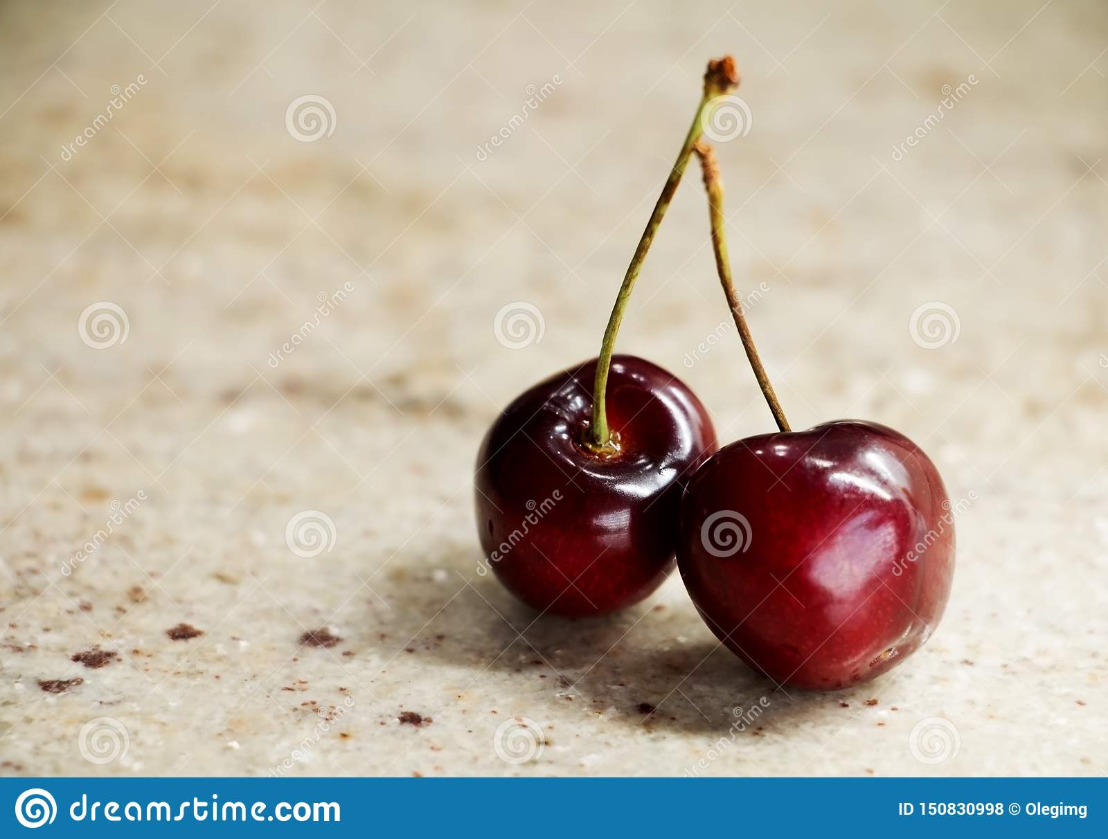 Bunch of sweet cherries on a granite table