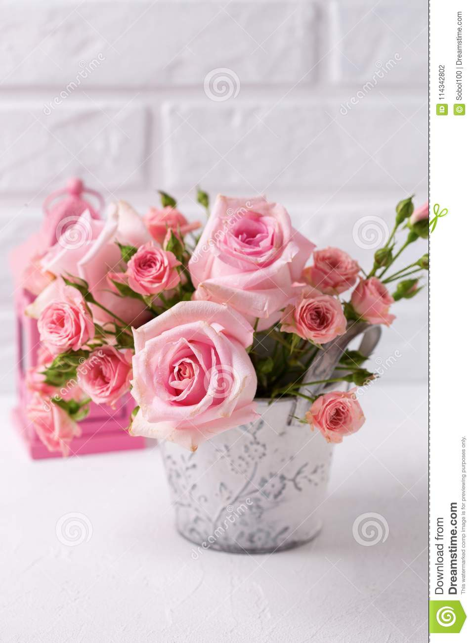 Bunch Of Tender Pink Roses Flowers And Decorative Pink Lantern Stock
