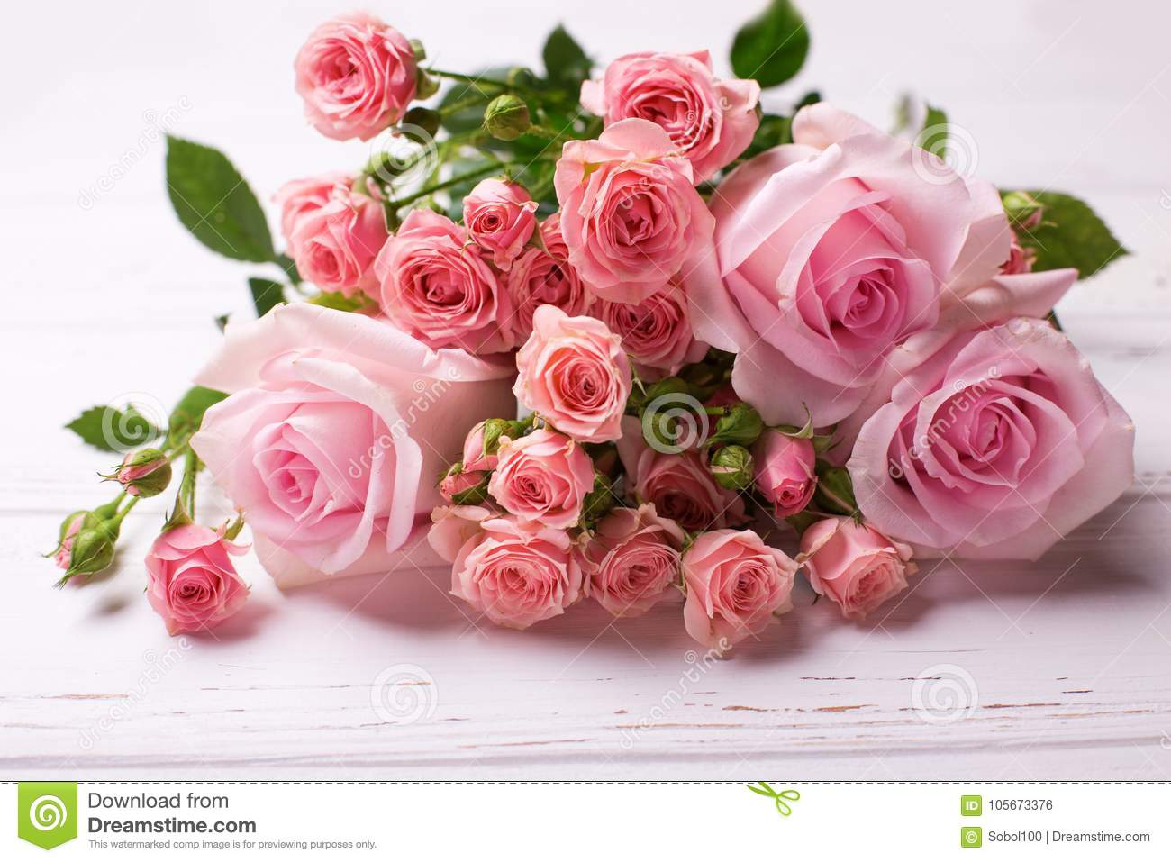 Bunch Of Tender Pink Roses Flowers On White Wooden Background Stock