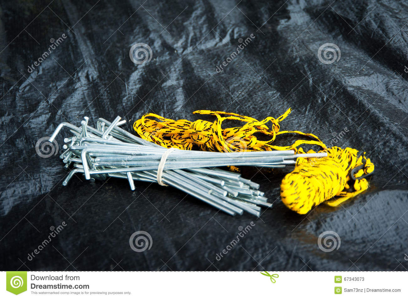 Bunch of tent pegs on black tent ground sheet & Bunch of tent pegs stock image. Image of sheet outdoor - 67343073