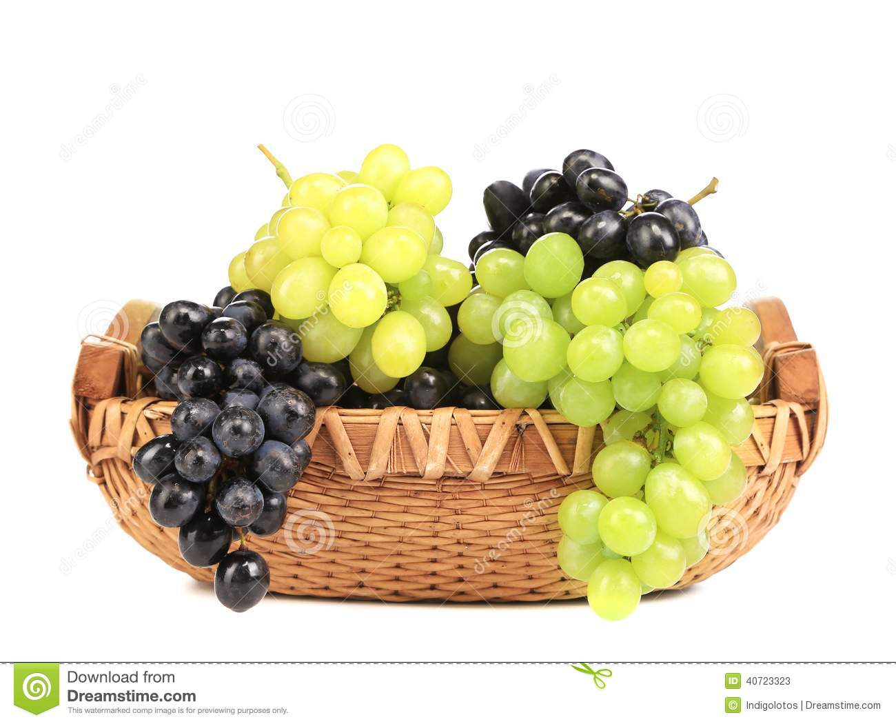 Bunch of white and black grapes in a basket.