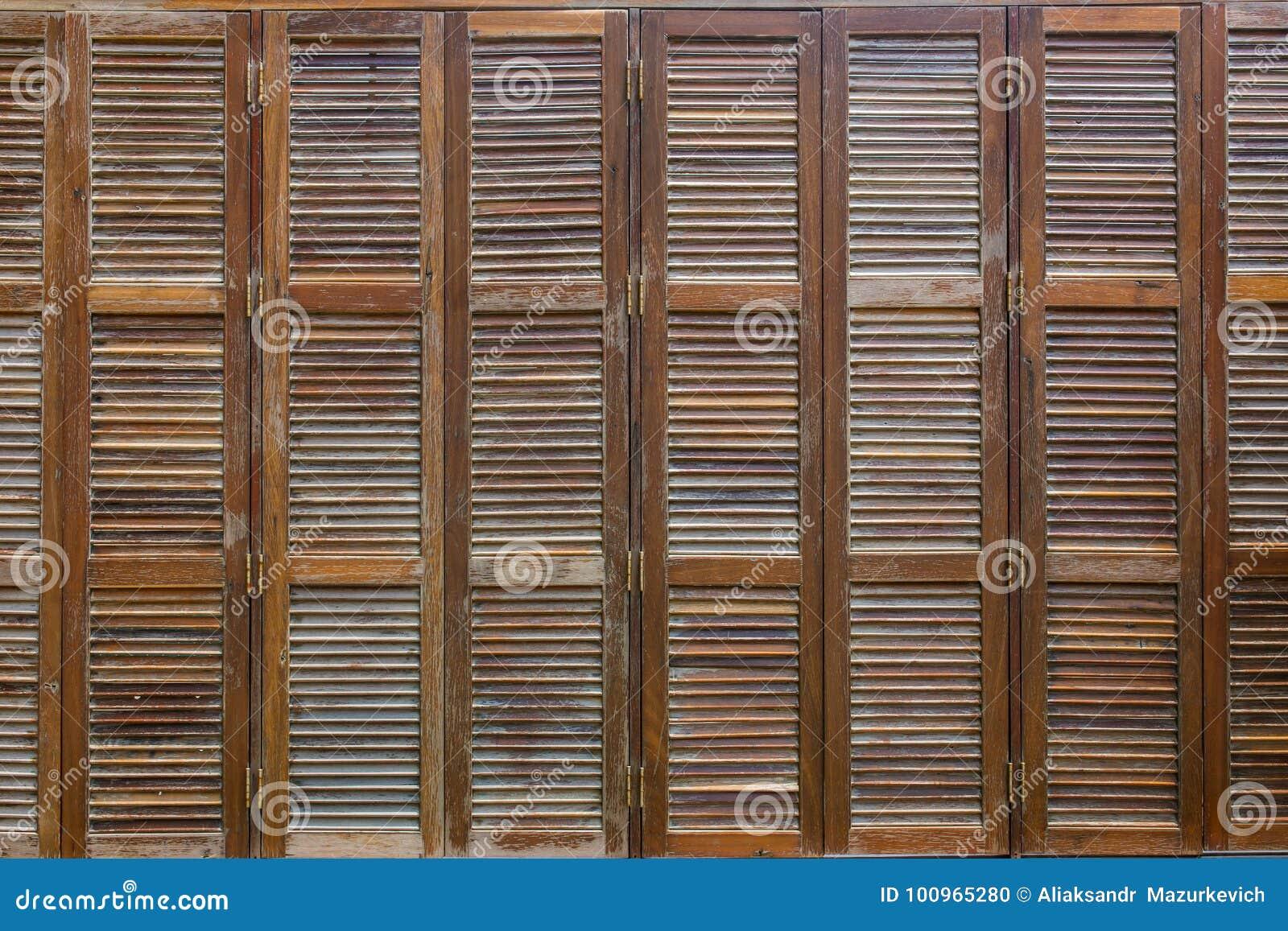 Bunch of wooden window shutters pattern background.