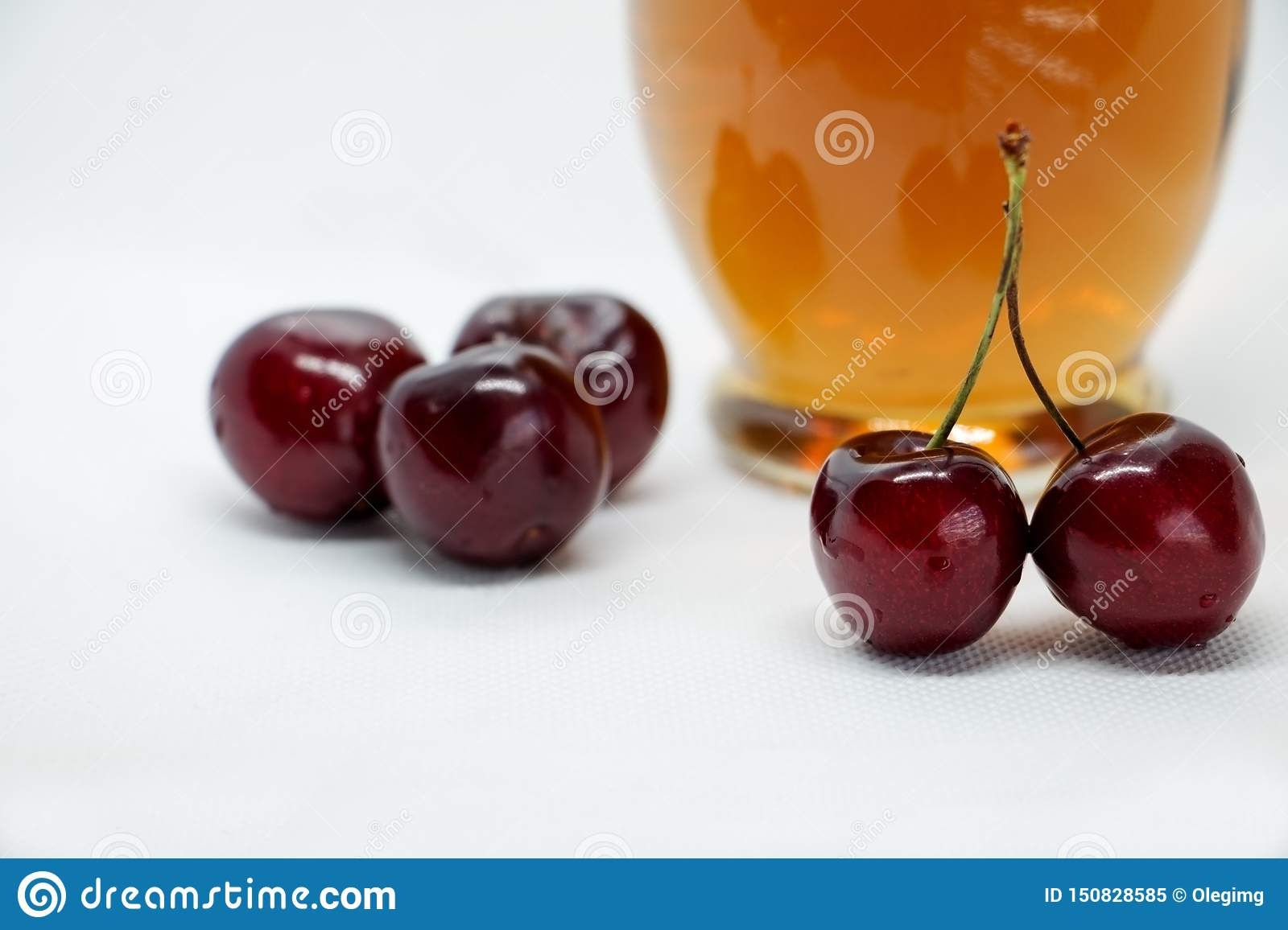Bunches of sweet cherries and a bottle of juice