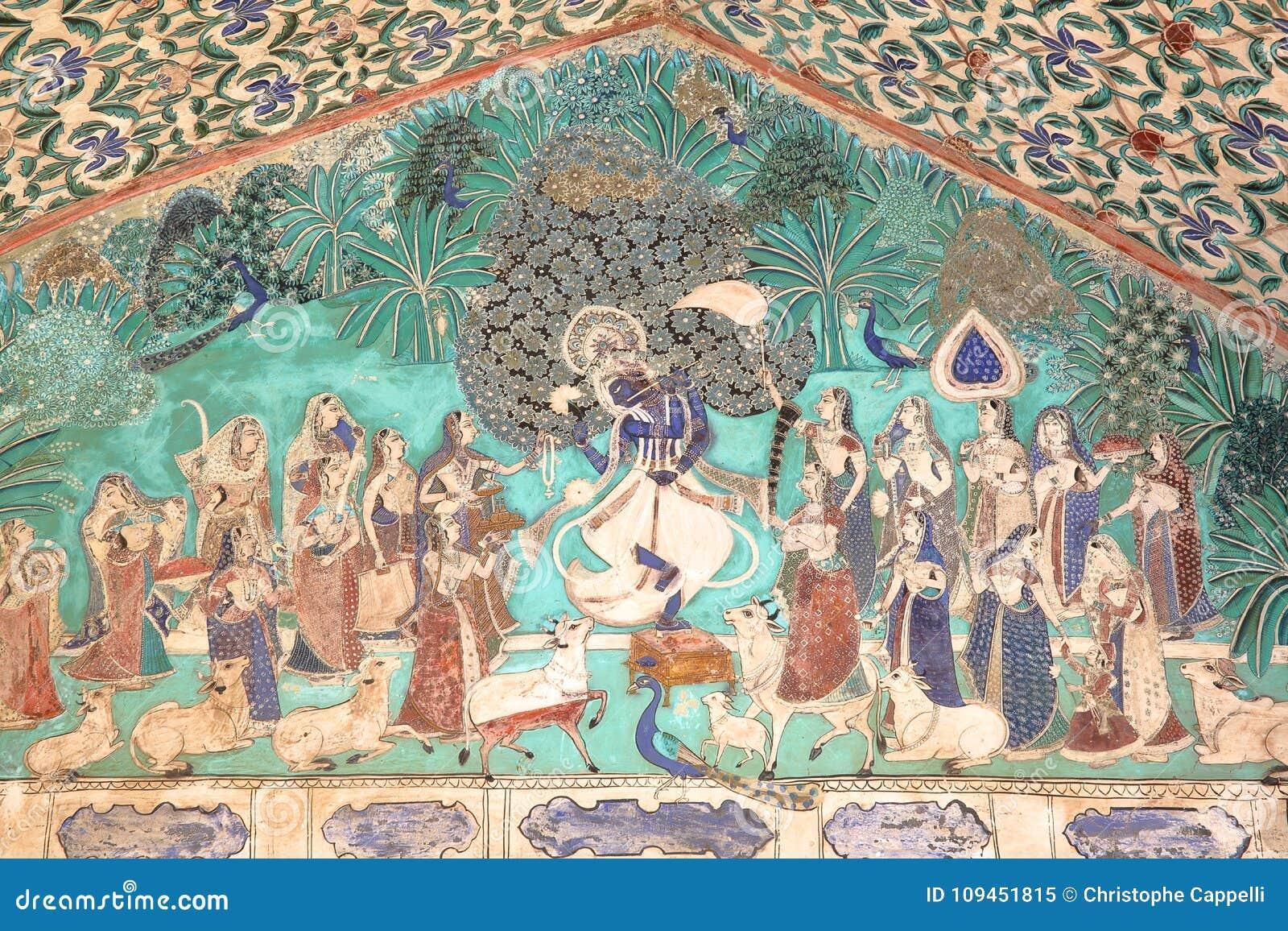 BUNDI, РАДЖАСТХАН, ИНДИЯ - 8-ОЕ ДЕКАБРЯ 2017: Стенные росписи на Chitrasala в дворце Garh Bundi показывая Krishna играя fl