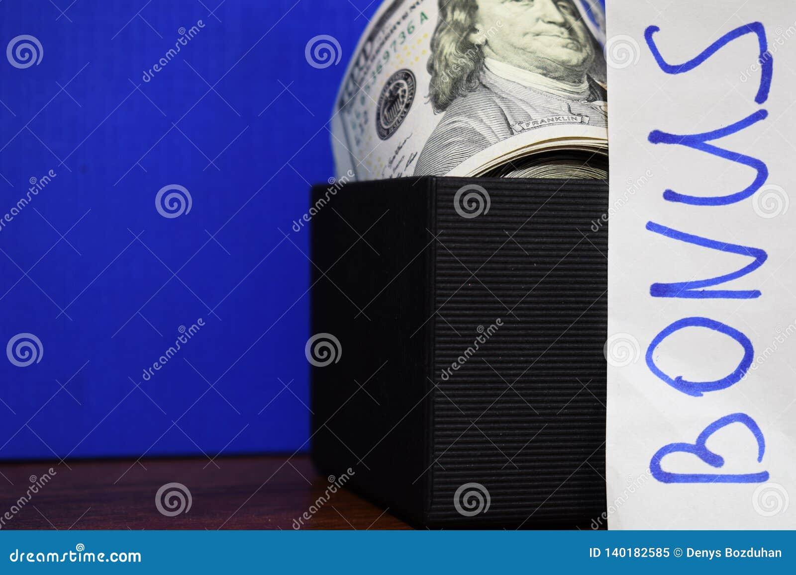 Bundle of dollars in gift box isolated on blue background, the inscription Bonus