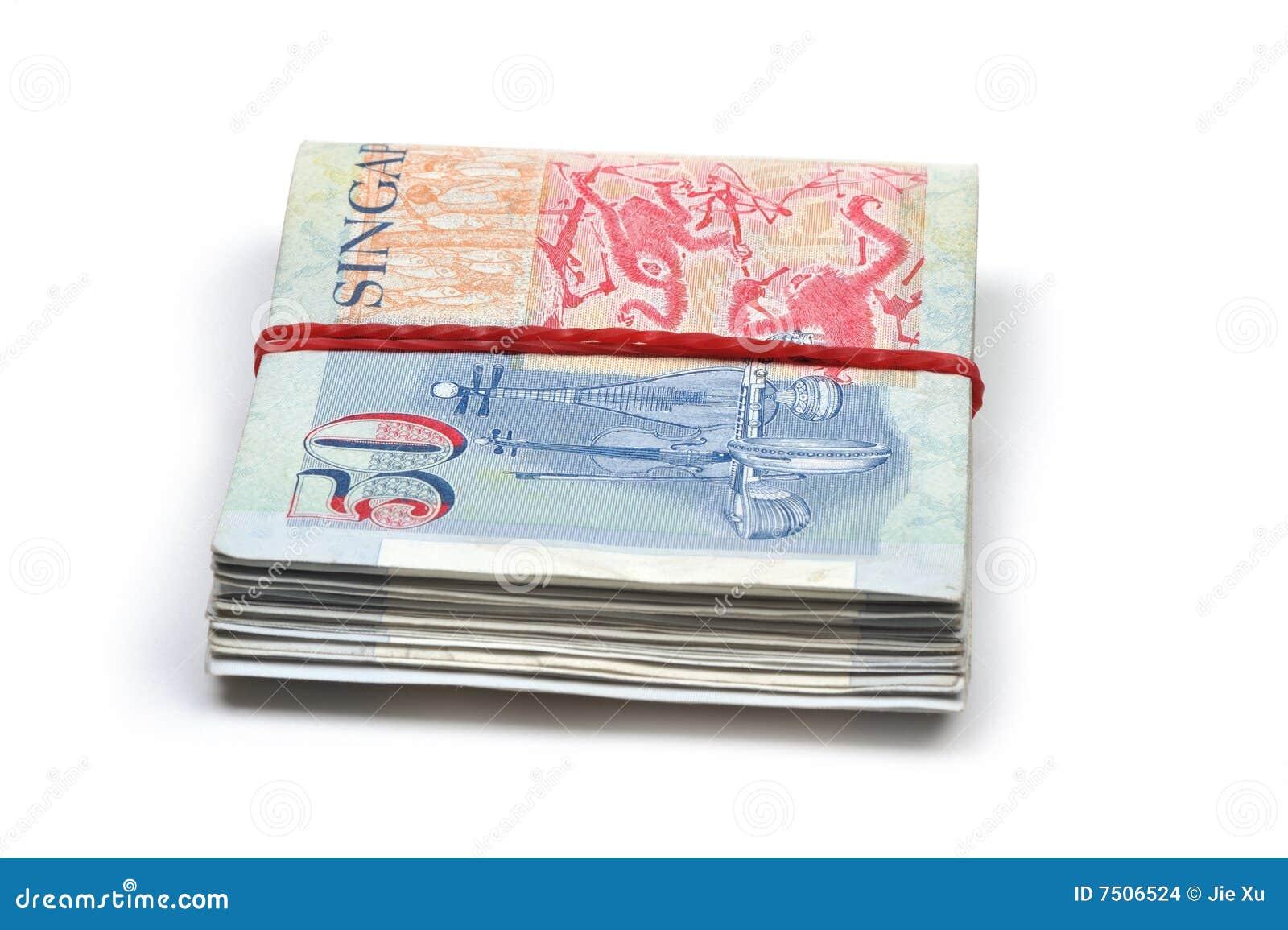 A Bundled Up Stack Of Singapore Dollars Stock Photo