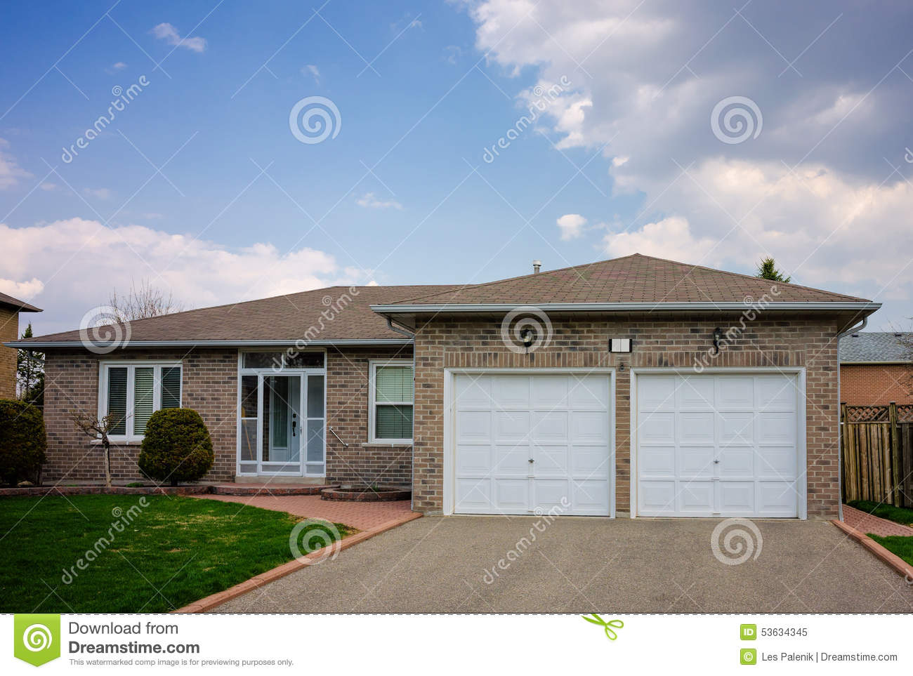 Bungalow with a double garage stock photo image 53634345 for Bungalow garage