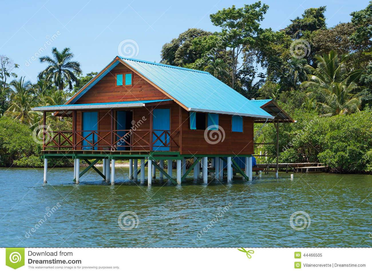 Bungalow on stilts over water of the caribbean sea stock for Bungalows sobre el agua en mexico