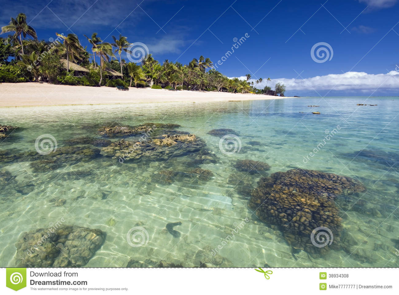 Bungalows On Tropical Beach With Coral Reef Stock Photo