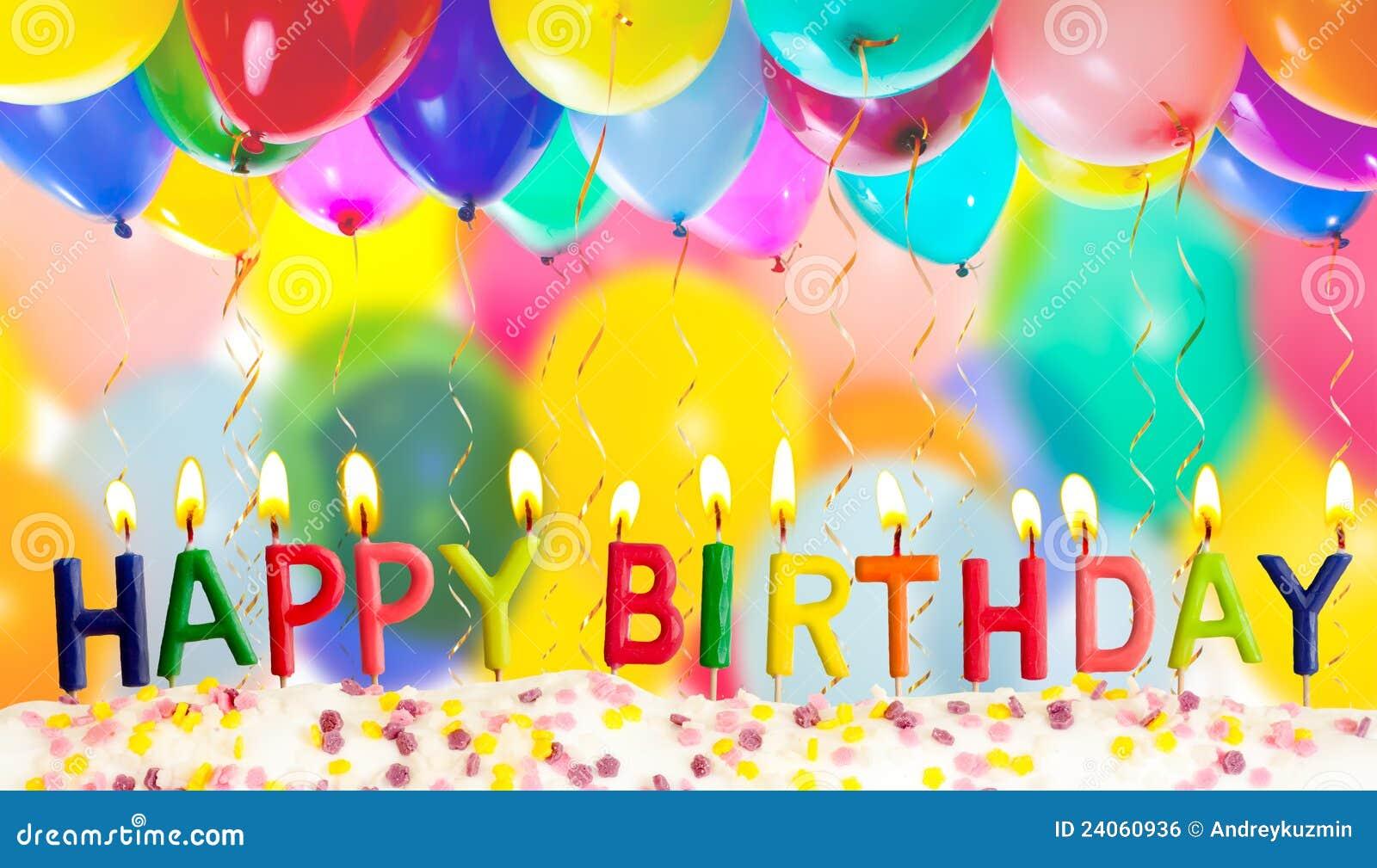 Buon compleanno illuminato candele sugli aerostati variopinti