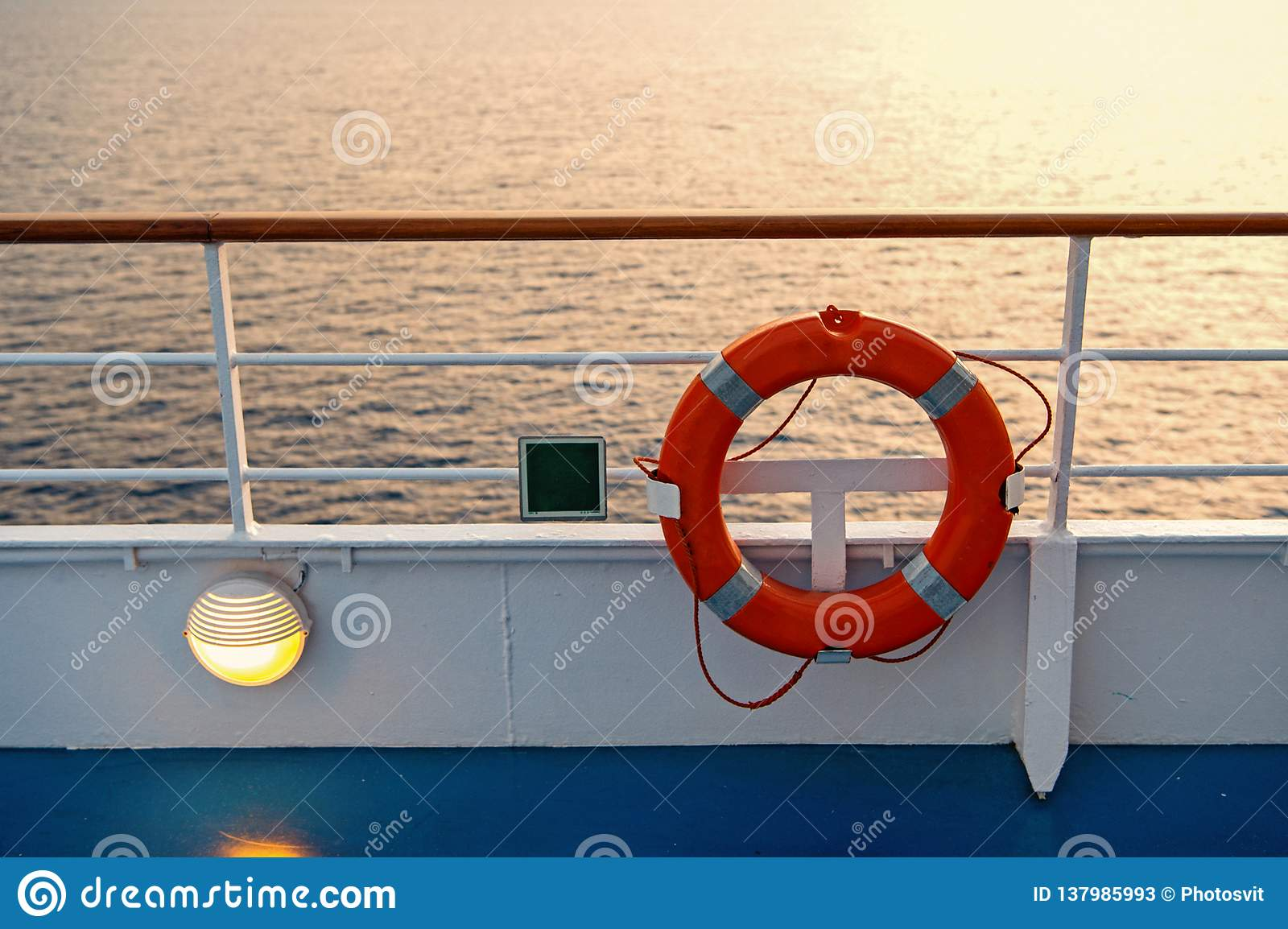 Buoy or lifebuoy ring on shipboard in evening sea in miami, usa. Flotation device on ship side on seascape. Safety