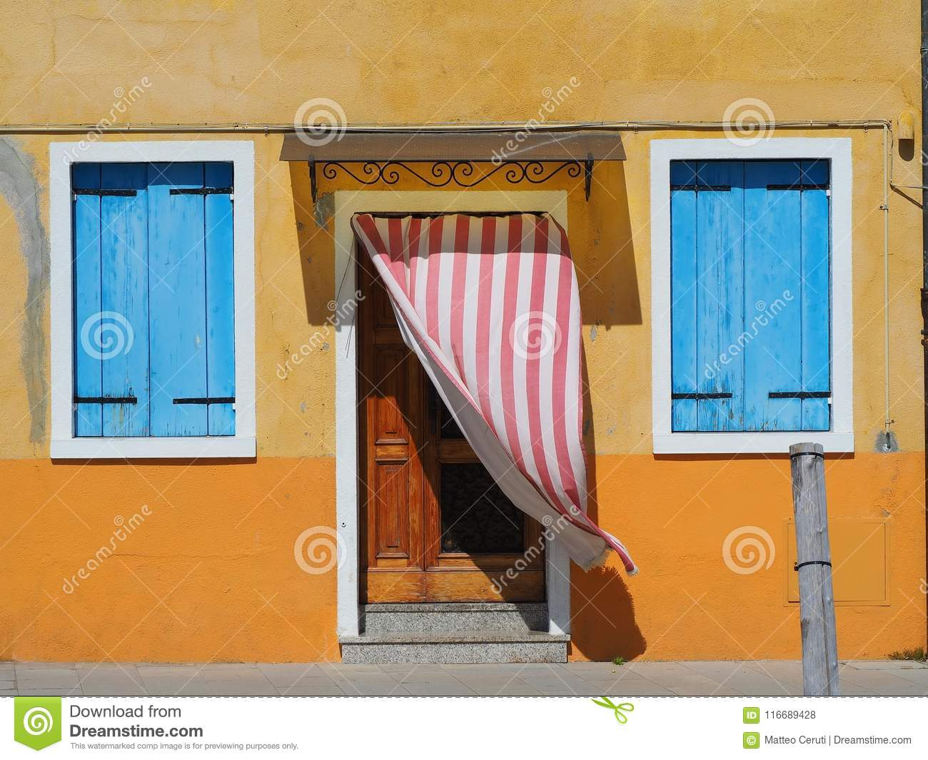 Burano, Venezia, Italy. Details of the windows and doors of the colorful houses in Burano island